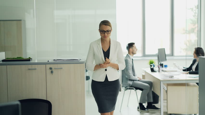 Stressed woman is standing in office room waiting for job interview expressing negative emotions fear and lack of confidence then walking to interviewer. | Shutterstock HD Video #1021441942