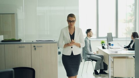 Stressed woman is standing in office room waiting for job interview expressing negative emotions fear and lack of confidence then walking to interviewer.
