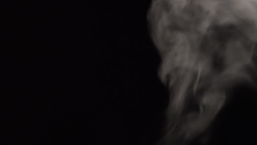 Slow motion video clip footage isolated black background of overlay flowing active white cloud, fog, gas and smoke beginning until end (fade in and fade out) empty copy space for text and content   | Shutterstock HD Video #1021486912