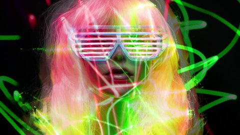 amazing mannequin with neon sunglasses with laser lights over her. very 1980s retro. not a real model, this is a mannequin head