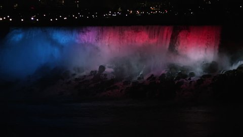 Niagara Falls at night in the winter time. Large waterfall flowing over rocks. Natural wonder of the modern world. Niagara Falls  waterfall.