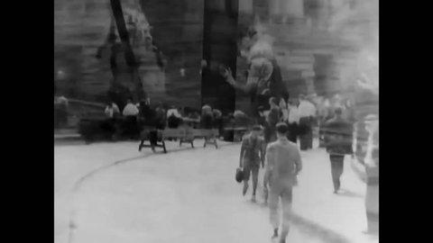 CIRCA 1937 - Men work on WPA transportation construction projects in Manhattan.