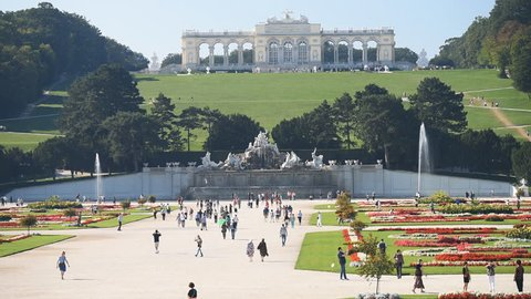 VIENNA, AUSTRIA - SEPTEMBER 18, 2018: Tourists walking on Great Parterre in Schonbrunn park. Schonbrunn palace and gardens is listed as UNESCO World Heritage site since 1996