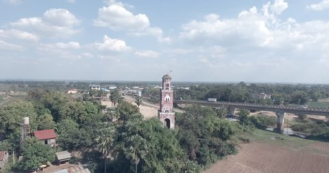aerial drone shot past the colonial french watchtower near a concrete bridge