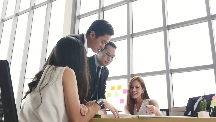 Asian Businesspeople are brainstorming while meeting together at the office.   Shutterstock HD Video #1021725232