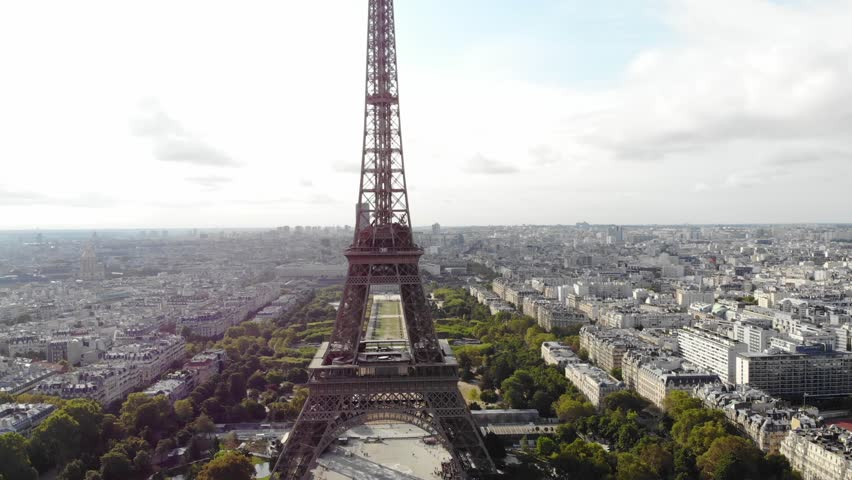 Aerial video of the Eiffel Tower on a sunny day in Paris France | Shutterstock HD Video #1021731922