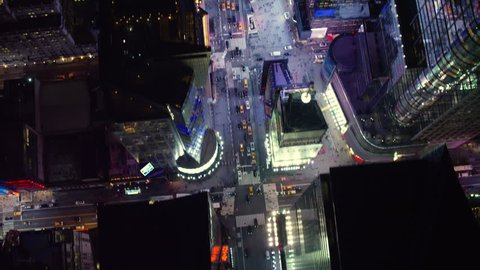 Top down aerial view of the streets and buildings in downtown Manhattan, New York City at night with dark lighting. Shot on 4k RED camera on helicopter.