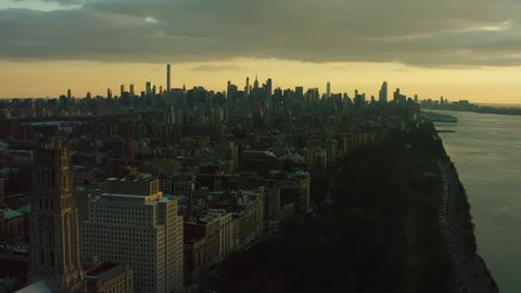 Aerial view of buildings near the Hudson River in Upper Manhattan, New York City, soft sunset lighting. Wide shot. 4k shot with a RED camera.