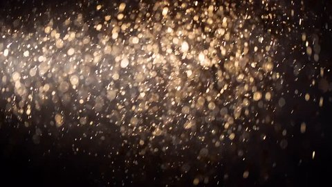 Golden Ascending Glowing Particles with Light Rays Motion Graphic Background