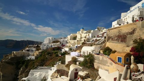 Picturesque cliffside town of Oia on the mediterranean island of  Santorini, Greece