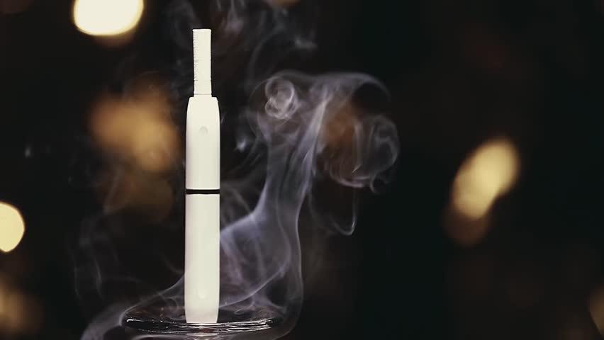 Electronic smoke device gold bokeh    Shutterstock HD Video #1021898242