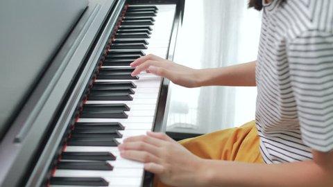 4K Asian girl playing piano