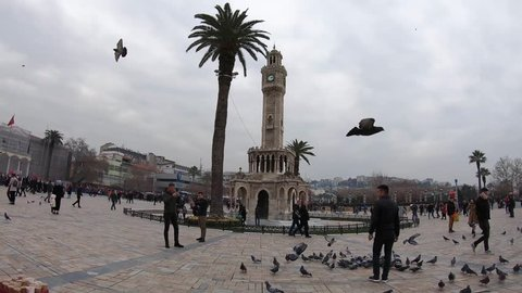 Izmir / Turkey - December, 2018: Hyperlapse rotation around famous Izmir Clock Tower.