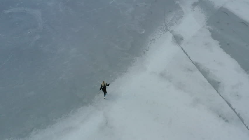 Ice Skating on a frozen lake in Norway #1022076112