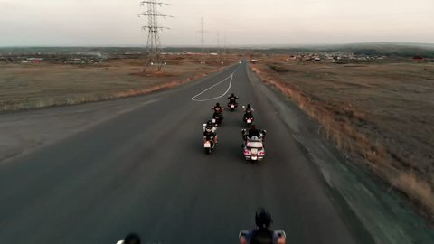 Group of moto bikers on asphalt highway. aerial view