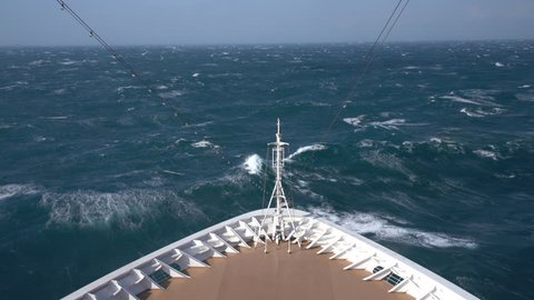 View down at the rough seas during a windy storm on a modern cruise ship in the ocean