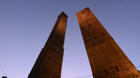 The two towers of Bologna. Asinelli, the tallest, and the Garisenda. Movie performed at sunset.