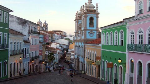 Salvador da Bahia, Brazil, aerial view of the historical district of Pelourinho showing colourful colonial buildings at twilight. Dolly right.