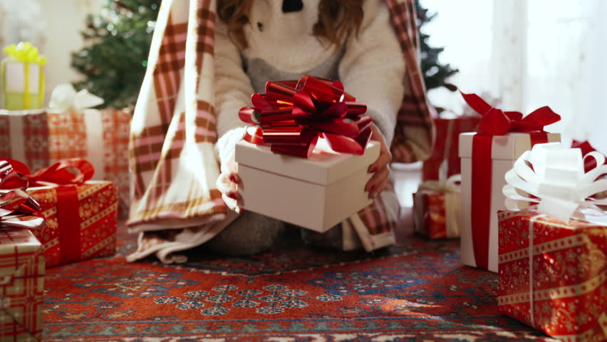 Christmas morning. Girl opens a gift. Dolly shot | Shutterstock HD Video #1022118892