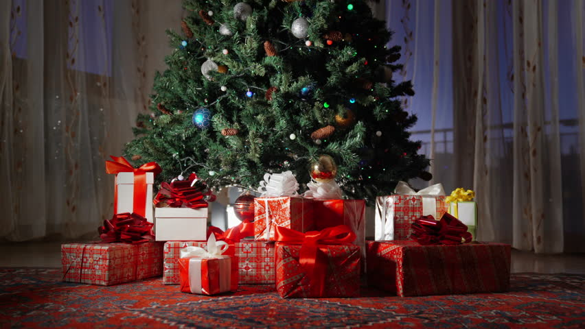 New year tree decorated with lights and Red gift boxs, christmas interior background. Blinking Garland. | Shutterstock HD Video #1022159902