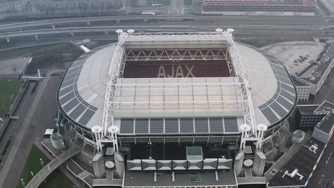 JANUARY 7, 2019, Amsterdam, Netherlands : Johan Cruyff Arena is the home of AFC Ajax soccer club in Amsterdam feat. interior and exterior from top above roof view and inside the stadium looking down.