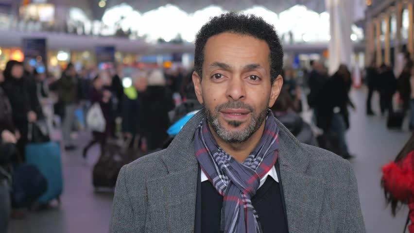 Black African businessman at a train station - LONDON / ENGLAND - DECEMBER 15, 2018 | Shutterstock HD Video #1022161852