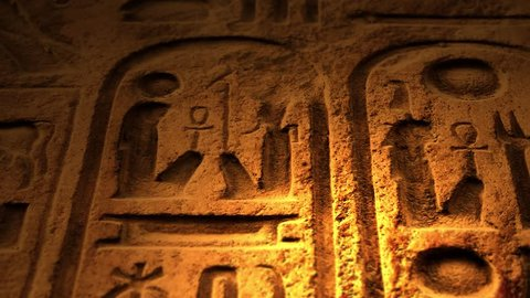 Ancient Egyptian Symbol of ten commandments or another object of ancient origin lit by candle ALT