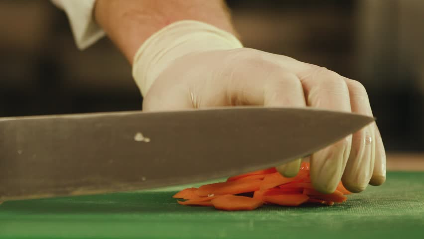 Cutting vegetables by a knife - chopping carrots. Close-Up Slow Motion | Shutterstock HD Video #1022181502