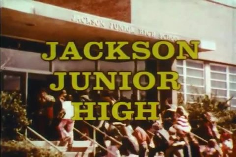 CIRCA 1970s - Students arrive at Junior High School in 1976