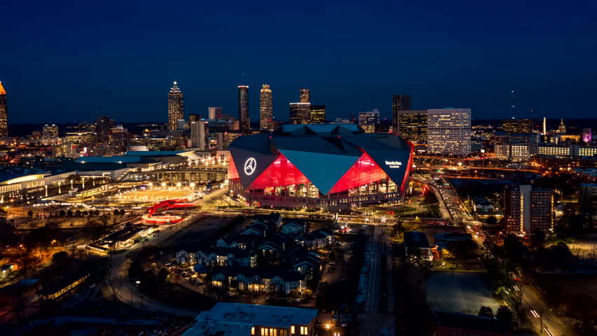 Atlanta Aerial v487 Dusk to night hyperlapse flying low to high over stadium toward downtown cityscape 12/18