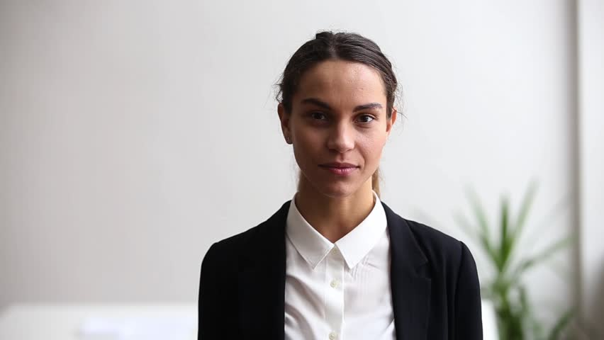 Successful confident millennial woman in suit smiling looking at camera, motivated professional employee, young teacher, lady hr manager, female office worker posing for video business portrait | Shutterstock HD Video #1022264182