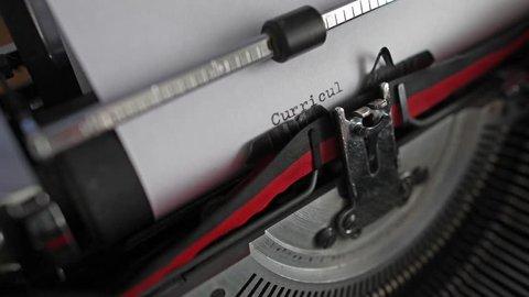 "Typewriter keys spelling out ""Curriculum Vitae"""