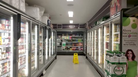 SANTA MARTA, COLOMBIA - NOVEMBER 2018: Smooth slow motion shot inside supermarket store (Refrigerated foods)