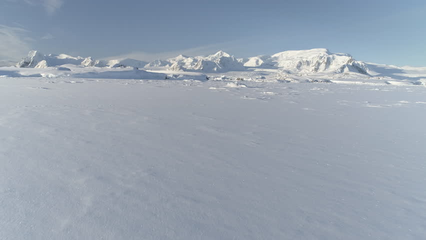 Snow Covered Antarctic Surface Timelapse Aerial View Flight. South Pole Ice Landscape. Winter Frozen Ground Continent Snowy Frost Rock Epic Drone Fly Footage Shot in 4K (UHD) | Shutterstock HD Video #1022358652