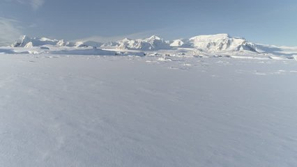 Snow Covered Antarctic Surface Timelapse Aerial View Flight. South Pole Ice Landscape. Winter Frozen Ground Continent Snowy Frost Rock Epic Drone Fly Footage Shot in 4K (UHD)