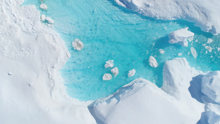 Antarcica Iceberg Turquoise River Top Down View. Nature Lake with Blue Water and Broken Ice Flow. Ecology, Melting Ice, Climate Change and Global Warming Concept Aerial Drone Shot Footage 4K (UHD)