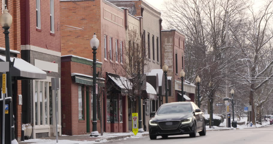 A long shot of a small American town's business district in the winter season. Pittsburgh suburbs. Non-snowing version. With audio.  | Shutterstock HD Video #1022398762