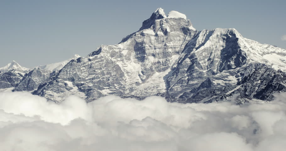 Mount Everest epic aerial wide shot panoramic view of snowcapped cold rocky mountains with clouds in Nepal near tibet with cloudy skies and fierce winds. | Shutterstock HD Video #10224239