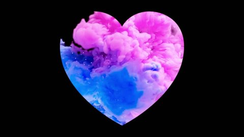 Abstract colorful ink drops in the water in slow motion mixing in Love shape heart. Perfect for valentines day. Blue and Pink ink paint drops swirling and mixing underwater.