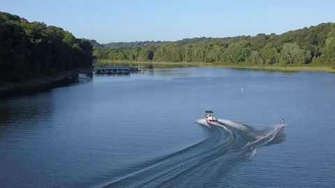 water skier letting go of the ropes and sinking into the lake water