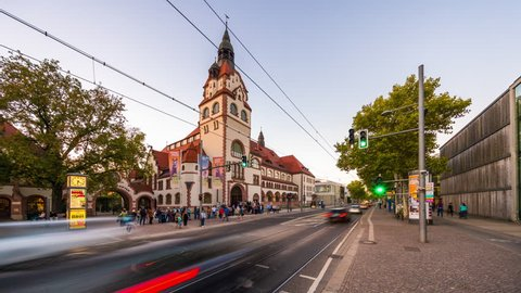 Leipzig, Sachsen, Germany - October 15, 2018:timelapse locked shot showing city zoo entrance and tram stop