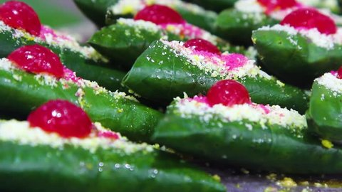 Closeup footage of sweet masala Paan, a preparation combining betel leaf with areca nut, tobacco widely consumed throughout South Asia, Southeast Asia, India and Taiwan as a mouth freshner after meal.