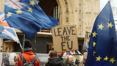 LONDON, circa 2019 - Slow motion shot of a group of Pro-EU remainers and Brexiteers demonstrating opposite Westminster Palace in London, England, UK