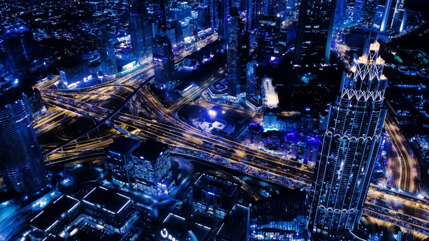 Fantastic view out of hotel highest level window on night Dubai with multi-level traffic interchange and skyscrapers | Shutterstock HD Video #1022630452