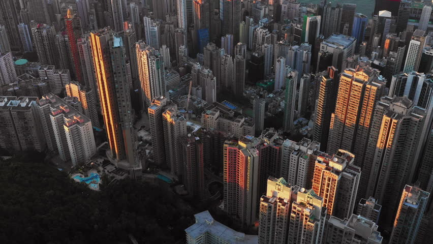 Fly over Urban city scene around Victoria peak and Victoria Harbour with Day light, Hong Kong Transportation, 4k high resolution video | Shutterstock HD Video #1022637772