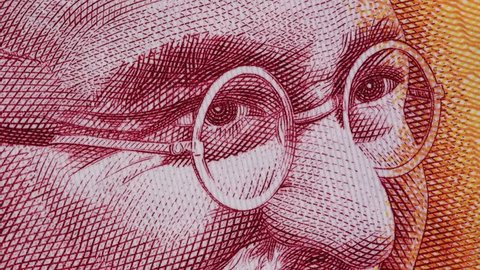 Mahatma Gandhi on India 200 rupee banknote macro slow rotating. Indian money currency bill. Stock video footage