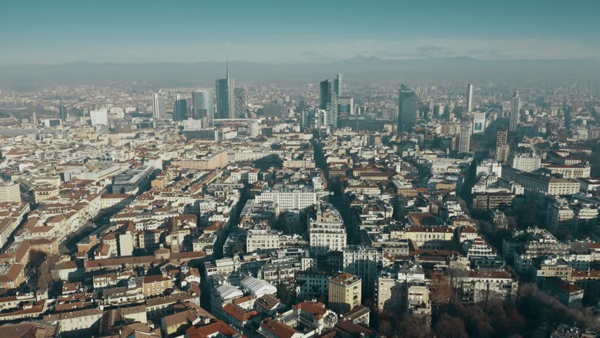 MILAN, ITALY - JANUARY 5, 2019. Aerial shot of the Porta Nuova business district skyscrapers within cityscape | Shutterstock HD Video #1022687182
