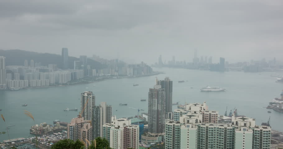 Look at the  panoramic view of Hong Kong skyline from the top of the mountain on a rainy day | Shutterstock HD Video #1022692642