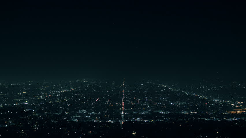 Los Angeles Grid at Night. a night view of Los Angeles Traffic and Population at night from the Griffith Observatory   Shutterstock HD Video #1022698492