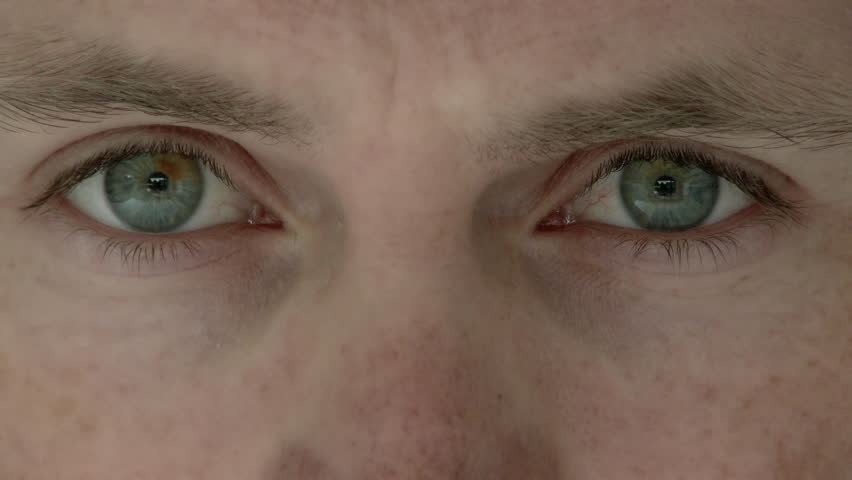 Close up of man's eyes looking up and into camera lens.